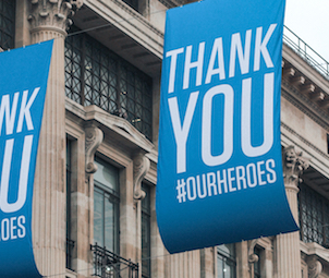 """blaue Flagge mit weißem Text """"Thank you our Heroes"""""""